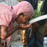 Water Missions International Bangladesh girl drinking water